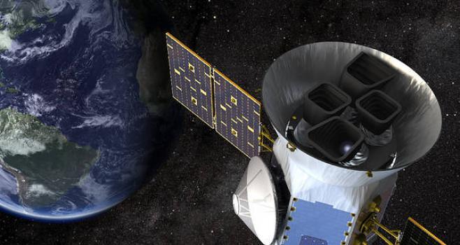 An artist illustration of the TESS satellite.