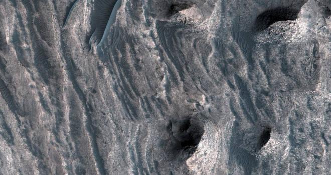 Layered sedimentary deposits inside the giant canyons of Mars