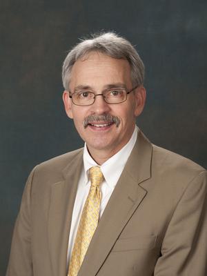 Dr. Wesley T. Huntress