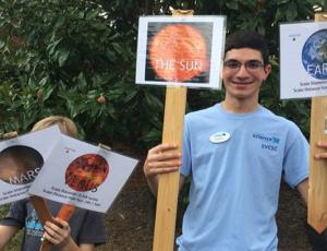 Young participants holding signs at Catawba Science Center