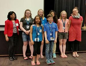 Elena Sparrow poses with Joanna Greene and her six students