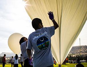 Students prepare balloons for launch