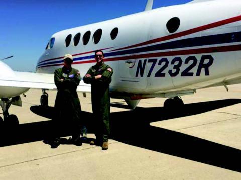 Photo of B200 aircraft and pilots