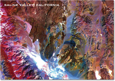 A false color satellite image revealing varied soil composition in the valley.