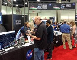 A man interacts with a display at a NASA booth