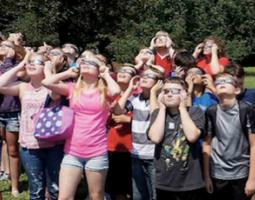 Students wearing eclipse glasses