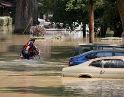 Photo of cars submerged in flood water