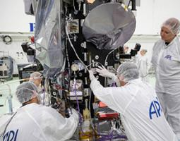 The plaque containing names submitted to travel to the Sun is mounted below Parker Solar Probe's high-gain antenna (the round object with gray covering), which the spacecraft will use to transmit data back to Earth.