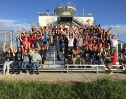 Students on bleachers celebrating the successful launch