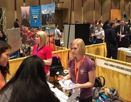 Two women provide information at a NASA Langley Research Center booth