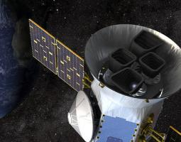 An artist illustration of the TESS satellite.
