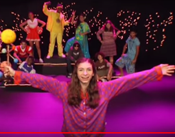 Photo of girl singing in space-themed musical