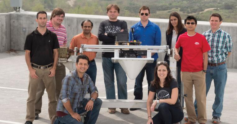 Photo of DopplerScatt team at JPL and Photo of DopplerScatt aboard an aircraft