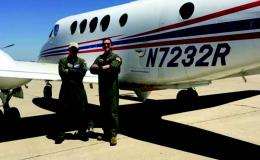 Photo of B200 aircraft and pilots