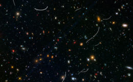 star field with galaxies and scratch marks