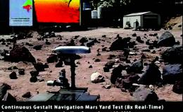 Video still frame of new rover navigating rocky terrain
