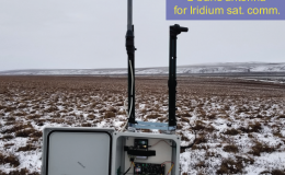Photo of SoilSCAPE base station in a field in Alaska