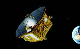 Artist illustration of LISA pathfinder spacecraft in orbit around earth
