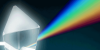 This photo of a prism show white light bending (or refracting) as it travels through the glass prism forming a rainbow.