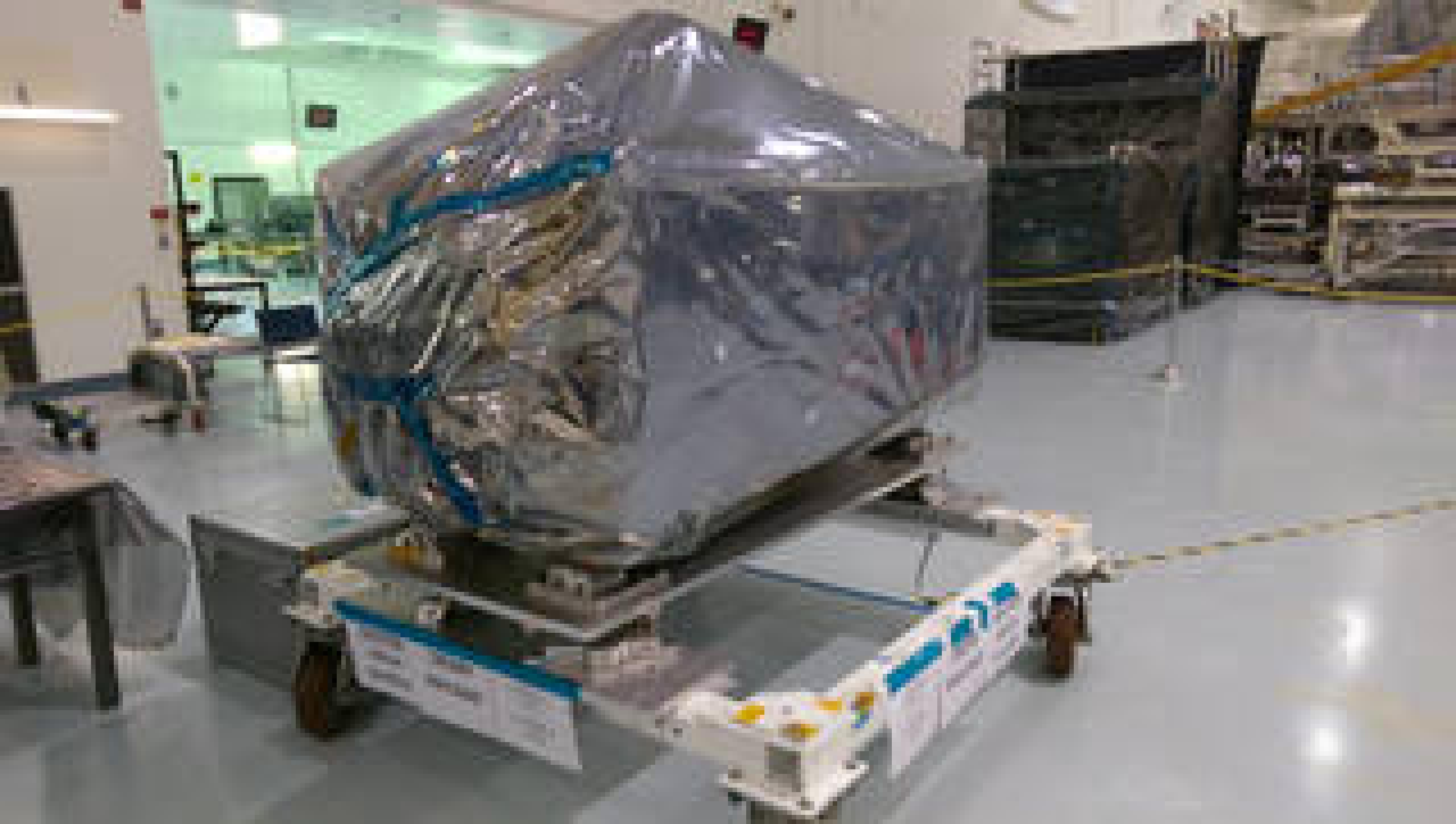 The ISS-CREAM payload was delivered to NASA's Kennedy Space Center in August 2015. The experiment is shown wrapped in plastic layers used to protect its sensitive electronics during shipment.