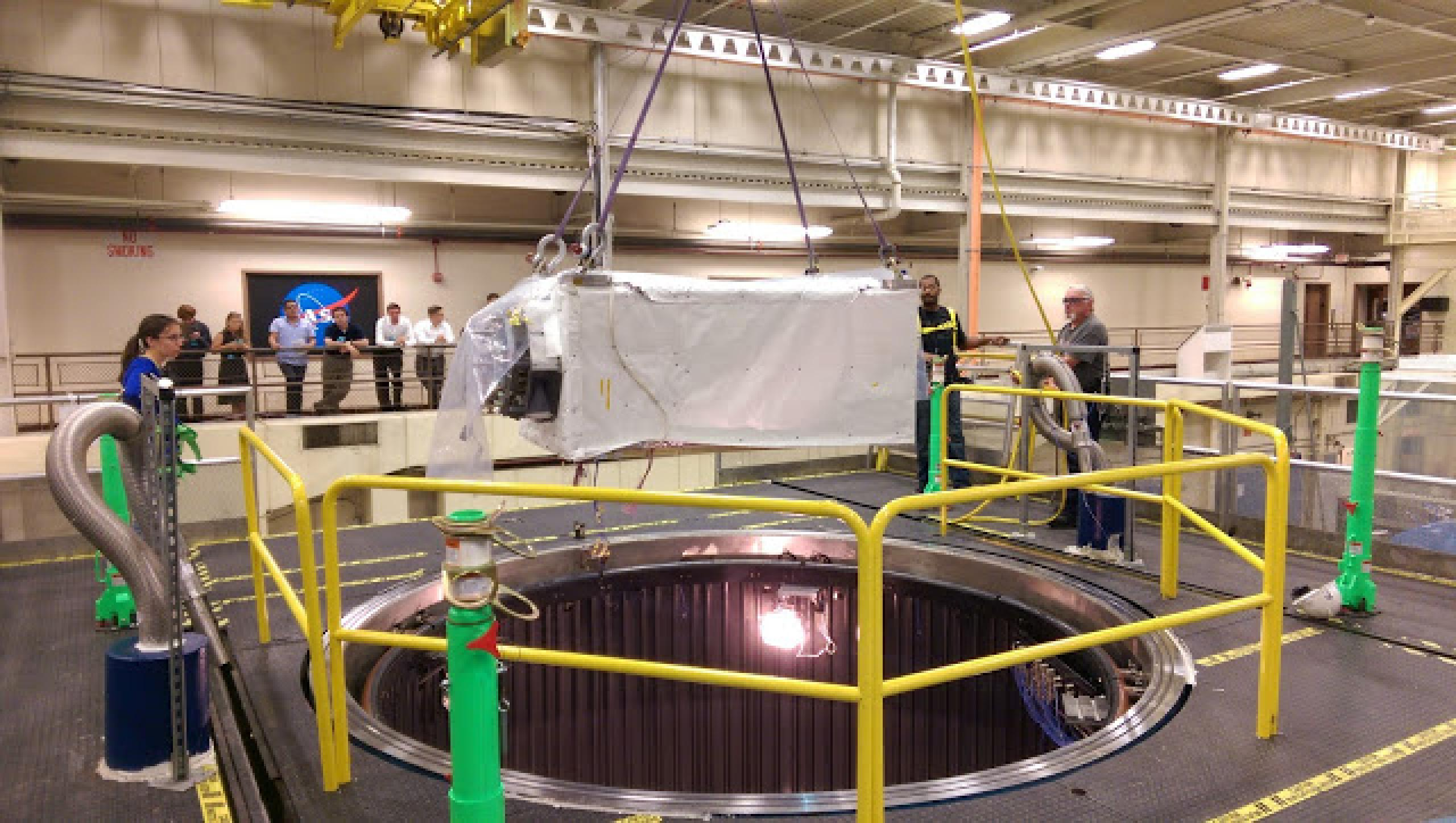Technicians lower ISS-CREAM into a chamber that simulates the space environment during system-level testing at NASA's Goddard Space Flight Center in summer 2015.