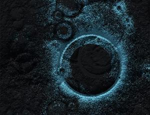 A glowing blue circle against a black background surrounded by faint, smaller blue circles