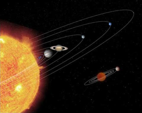 Artist concept of the planets in their rotation around an orange sun with solar flares