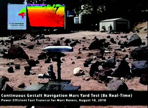 Video still frame of new rover navigating rocky terrain