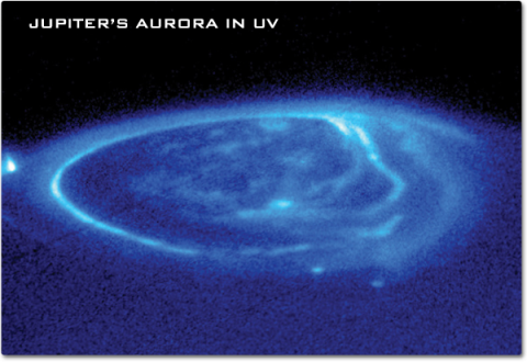 A close-up of Jupiter's pole showing an aurora as a wispy ring of light blue color.
