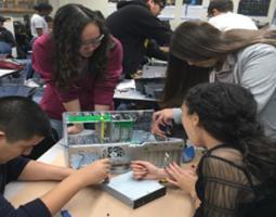 Students take apart a computer