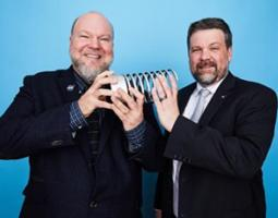 Two men holding a Webby award.