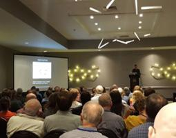 Dr. Paul Schenk presenting a keynote address