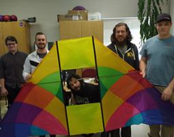College students pose with a big kite.