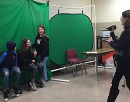 Kids creating Spotlite video in front of a green screen
