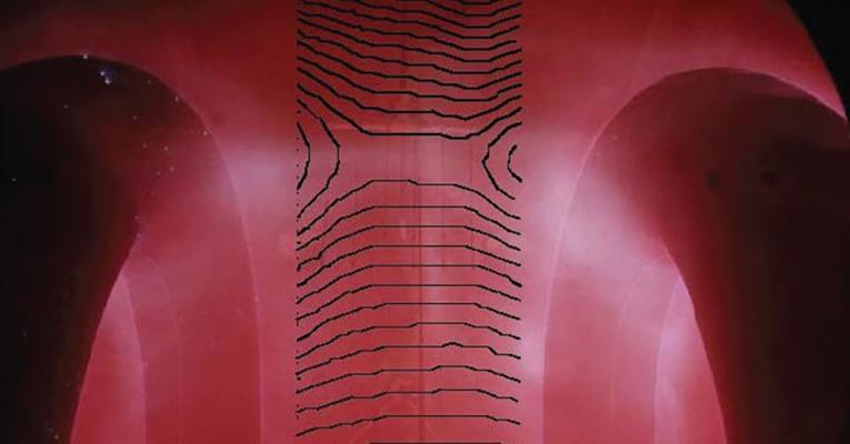 Photo of the magnetic fields of coils represented by shades of pink for the magnetic fields and black lines for the coils.