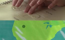 Fingers reading braille map of eclipse above animation of eclipse travelling across map of US